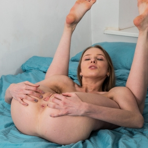 Flexible gymnast spreading her legs wide open