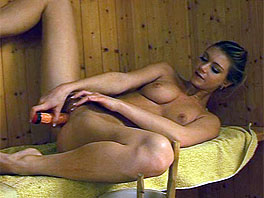 Megan masturbates in the sauna