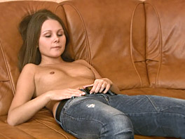 Liza plays with her pussy on the couch