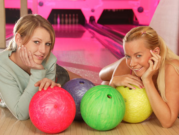 Young lesbians fuck each other in the bowling alley