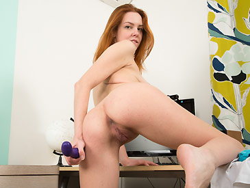 Super cute red head toying herself