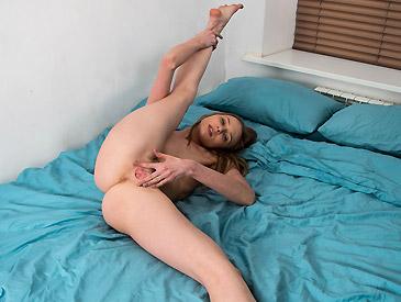 Flexible gymnast spreading her legs wide open