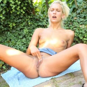 Blonde beauty rubbing her clit